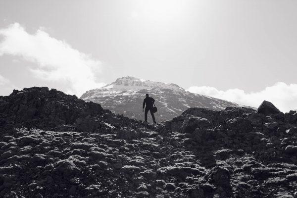 Grit person climbing a mountain